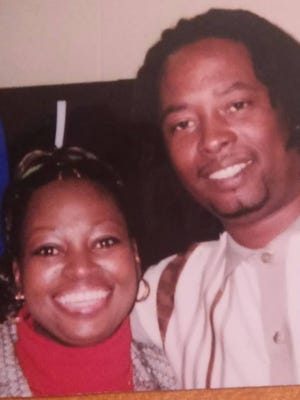 Provided photo of Samuel DuBose, 43, with Terina DuBose-Allen. DuBose was fatally shot by University of Cincinnati police officer Ray Tensing on July 19 in Mount Auburn.