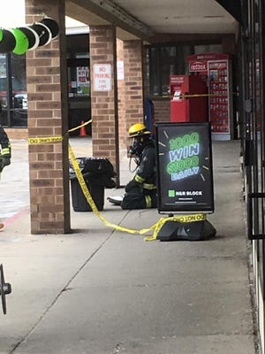 Outside the office with the hazmat team.