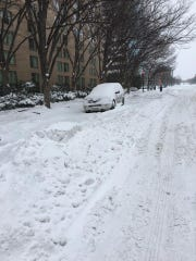 A snow-covered car in downtown Washington D.C.