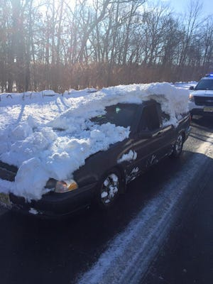 Howell police stopped a Volvo that was carrying several inches of snow on the hood trunk and hood.