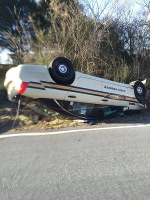 A Tennessee Highway Patrol trooper's vehicle overturned Saturday when he attempted to overtake another vehicle that was turning into a driveway.