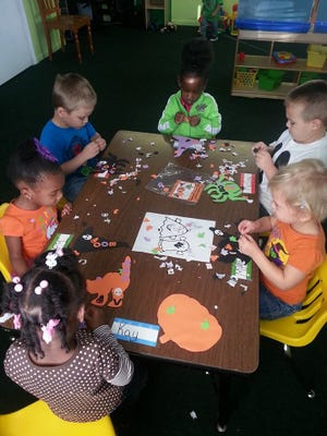 Students work on crafts at the Treetop Learning Center.