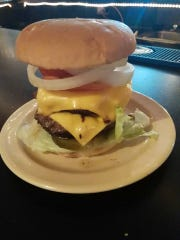 Get your burger stacked at Dewayne's Handlebar.