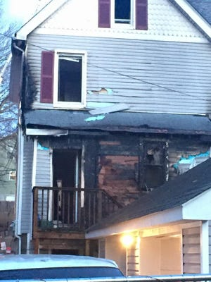 The damage left on the back of a home on Harrison Avenue in Peekskill Monday, Feb. 22, 2016.