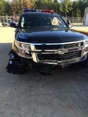 The damage shown to the Bossier Sheriff Deputy's car.
