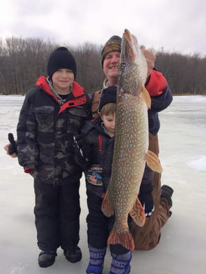 Brayden, Brent and Bryce with another good pike in central Wiscosnin