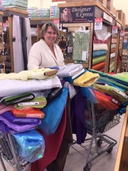 """Costume Designer Donna Morris fills up two shopping carts of fabric for the costume material needed for """"The Little Mermaid."""""""