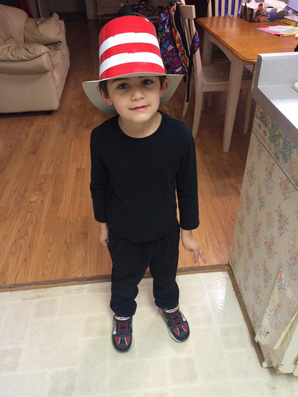 Gabriel wearing a hat for Dr. Seuss day made by his
