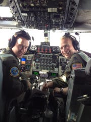 Nate Richeson, right,  flying a KC-135 Stratotanker