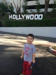 Yoshi next to a mini Hollywood sign.