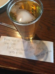 A note and a beer left by three women as a tribute to Susan Farrell.