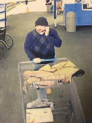 A man seen leaving Wal-Mart, allegedly stealing surveillance equipment.