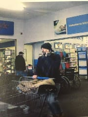 A man seen on camera in Wal-Mart taking surveillance equipment.