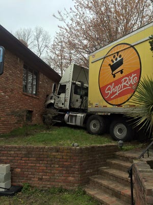 A tractor trailer struck a home in Tinton Falls on Wayside Road.