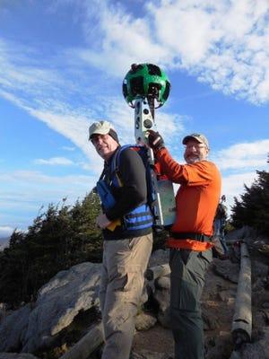 Duke Rose, left, prepares to haul the Google Trekker over the Black Mountain Crest Trail last fall, assisted by Jake Blood.