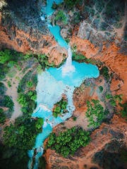 """Havasu Falls looks like a blue-green paradise in this drone's-eye-view photo taken by Raymund Rey and Ivan Liu of California during their Havasupai camping trip. They say: """"It was an awesome place. It's highly recommended. a must see!!!"""" See more of their photos at instagram.com/mhndztr and instagram.com/ivananthonyl."""