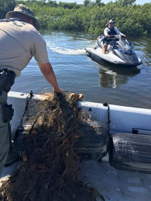 Lee County AShewriff's Office members come across gill nets, for the second time in three weeks, in Lee County waters. Gill ners are illegal in the state.