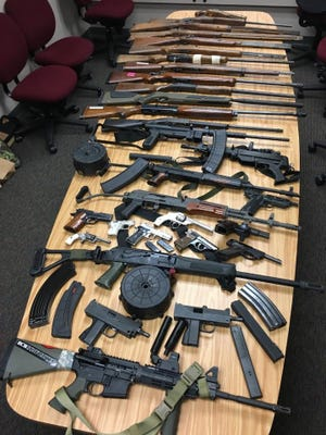 35 firearms and thousands of rounds of ammunition were seized from a Dodge County residence by a Swat team on Wednesday. Two men at the home were arrested.