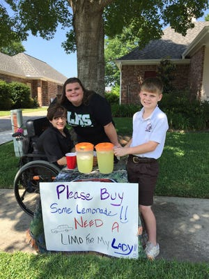 Logan Watkins, his prom date Ali Wood and Logan's brother, Lucas, work at Logan's lemonade stand. Initially, Logan wanted to raise money to rent a limo to go to Lafayette High's prom with Ali. Now he is raising money to donate to charity.