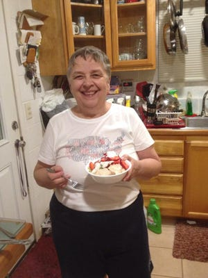 """Paulette Coulter, a.k.a. """"Mrs. Sarah's Mom,"""" shown in her kitchen in March 2015."""