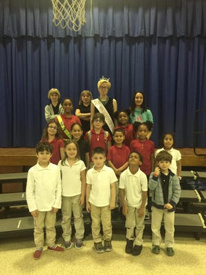 Miss Gloucester County's Outstanding Teen Shellby Watts visits with students in the YMCA's before- and after-school program at Winslow Elementary School in Vineland.