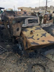 An armored vehicle is left damaged after blowing up during a battle with ISIS May 3 in Iraq.