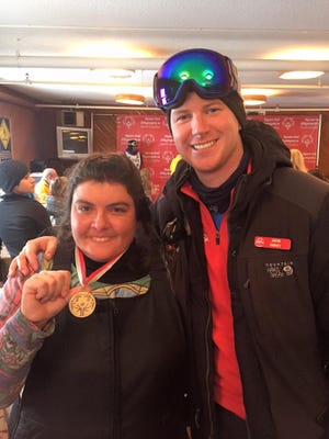 Special Olympics ski coach Jake Harkey, left, with a competitor at the 2016 Southeast Special Olympics Games.