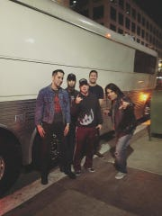Albatross Overdrive pose in front of their tour bus outside The Federal Bar in Long Beach. Albatross Overdrive is composed Art Campos (vocals), Davey Obade (bass), Rodney Peralta (drums), Derek Phillips (guitar), and Andrew Luddy (guitar)
