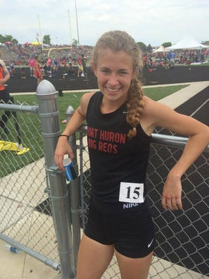 Port Huron's Rachel Bonner smiles after winning the Division 1 state championship in the 1,600 run.