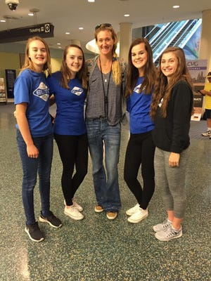 Boone County athletes with Tri-State Elite volleyball club greeted Olympics-bound competitor Kerri Walsh Jennings at Cincinnati-Northern Kentucky International Airport. From left: Florence residents Lucy and Lilly Trump, three-time Olympic gold medalist Kerri Walsh Jennings, Madison Willging of Burlington, and Lauren Welch of Union.