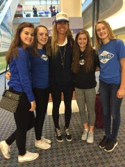 Boone County volleyball players greet April Ross at CVG on her way to qualify the Rio Olympics at the AVP Tournament in Mason, Ohio. From left: Madison Willging of Burlington, Lilly Trump of Florence, Olympic athlete April Ross, Lauren Welch of Union, and Lucy Trump of Florence.