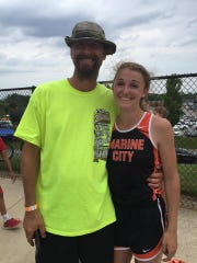 Hannah Coverdill stands with her father Dan Coverdill after winning the 300 hurdles at the Division 2 state meet.