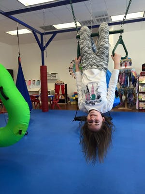 A child plays at We Rock the Spectrum Kid's Gym, designed to help children develop neurological skills. The franchise will open a location in Westfield this summer.