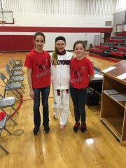 Natalie Hershberger with two young fans after making