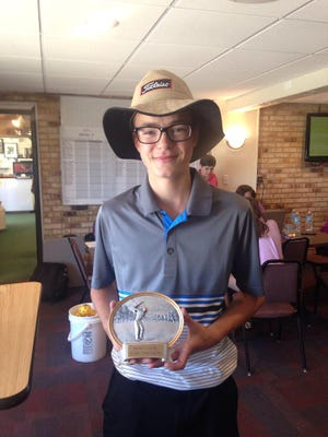 Evan DeBruyne, 15, of Chesterfield poses with his first place trophy after winning the 14-15 boys Blue Water Junior Golf Tour event at Port Huron Elks.