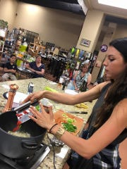 Christina Sciarrillo performs a cooking demonstration at Whole Foods in Lafayette.
