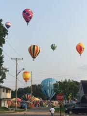 Hot air balloons take off from Freer Field at the 2015 Ashland Balloonfest.