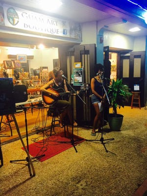 Amber Word (left) and Jessica Rohr, founders of ArtWalk Guam and Melancore are seen here performing at the first ArtWalk during the Festival of Pacific Arts 2016.