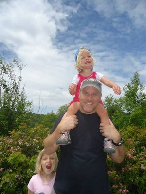 My husband and our daughters, on a hike.