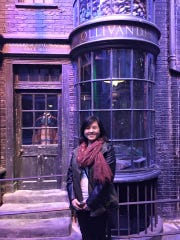 Austeen Yang standing in a Harry Potter set at the Warner Bros. Studio Tour London.