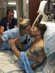Alix Cirigliano kisses fiance Brett Epps after their successful kidney transplant operation