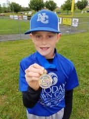 Tyler Reinhart shows his sectional winner medal in