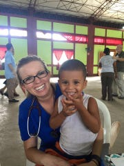 Whitney Gravelle holds a child during a four-day clinic last month in Leon, Nicaragua.