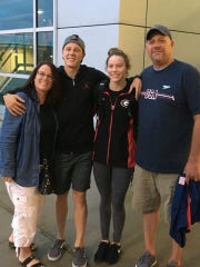 Spring Grove's Hali Flickinger, second from right, poses with her family at the U.S. Olympic Team Trials in Omaha, Nebraska. From left are mother Lea, brother Chris, Hali and father Doug.