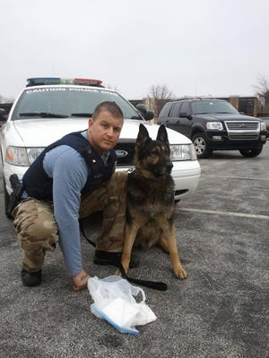 Former Michigan City police officer Rob Grant and his K-9, Henry, had a special bond. The two were buried together after a new law allowed service and law enforcement animals to be buried with their owners.