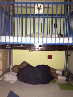 This photo of Andre Palmer Jr. sleeping under his son's hospital bed went viral, attracting global attention. Palmer believes the photo, taken by his wife and posted on Facebook, made people feel good at a time when the news from around the country was so bleak.