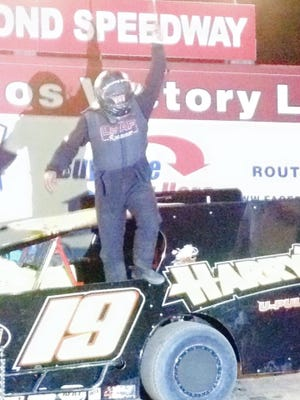 Shawn Light climbs out of his car after winning the Sportsman race at Big Diamond Speedway on Friday.