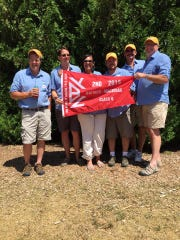 The Chippewa crew poses with their second place Class Q flag they won in last year's Port Huron-to-Mackinac Sailboat Race.