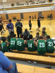 Houston County's players listen to former head coach