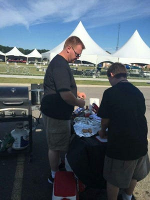 Brian Markonni and his son, Blake, get ready to barbecue at the All American BBQ Throwdown last year.